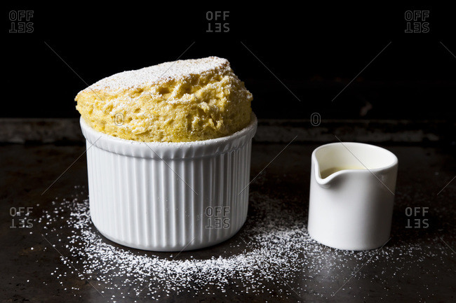 Souffle in a ramekin dusted in powdered sugar