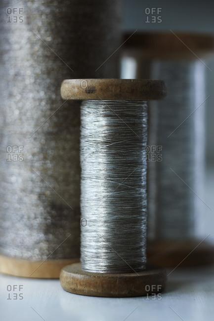 Three vintage spools of silver thread