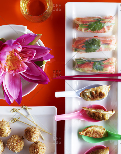 Colorful japanese appetizers with exotic flower.