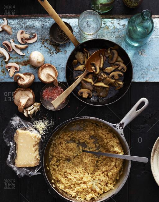 Preparing mushroom risotto.