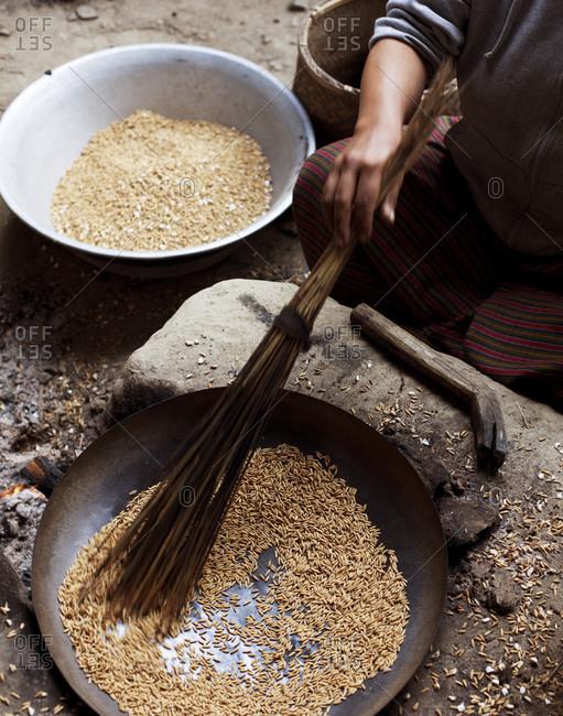 A sitting woman preparing dinner