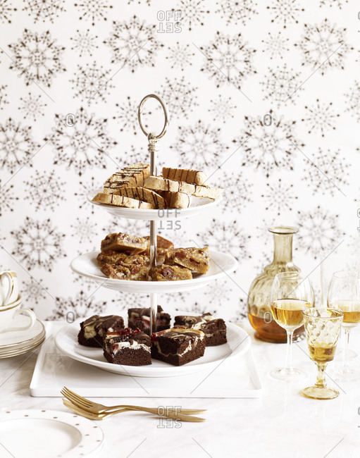 Different types of cookies on a cake stand.