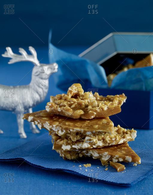 Crunchy brittle pile on a blue napkin.