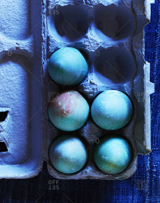 Blue eggs for Easter decoration in carton