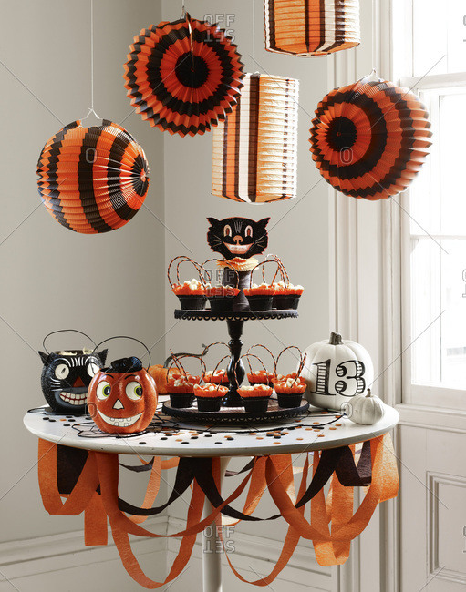 Halloween decoration and cupcakes on a table