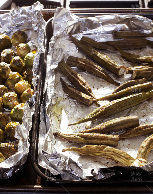Roasted brussels sprout and okra on aluminium foil
