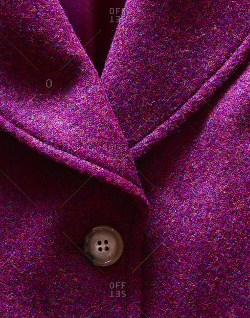 Pink jacket close-up with one button and collar