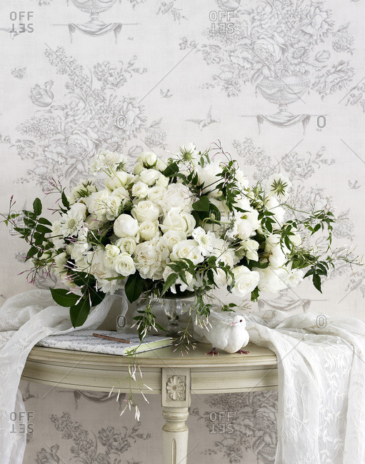 Centerpiece of white roses and dove