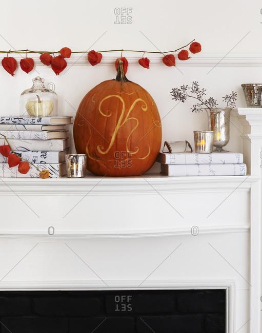 Carved pumpkin on a mantle