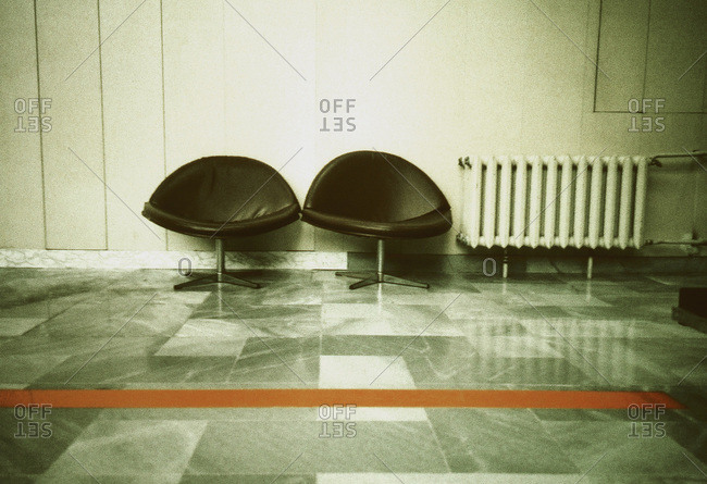 Two black chairs in a waiting lounge