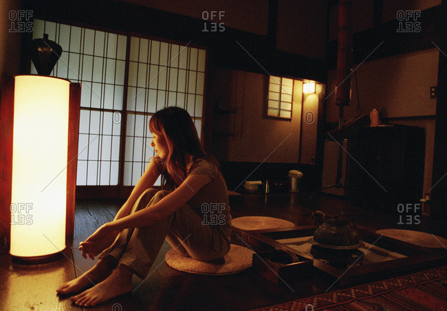 Japan, woman sitting in a hotel room