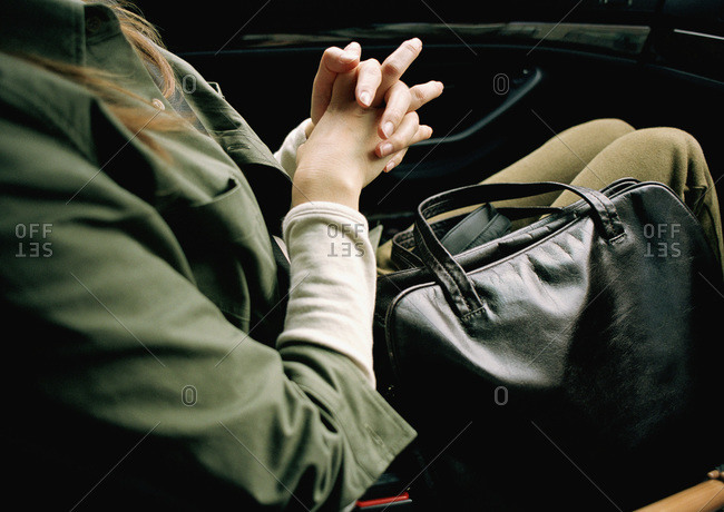 woman sitting in a car with handbag