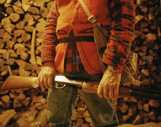 A hunter's torso and shotgun
