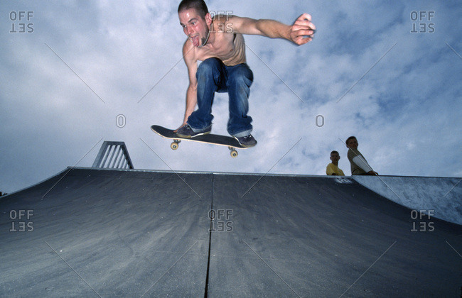 Man on skateboard jumping in air