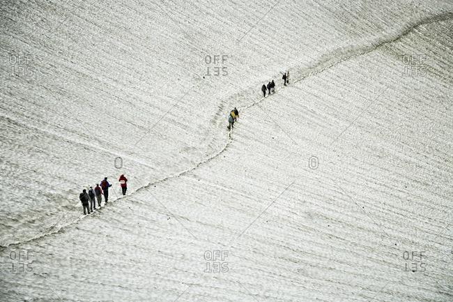 Hikers ascending the Mutnovsky Volcano, Kamchatka, Petropavlovsk Kamchatsky, Russia