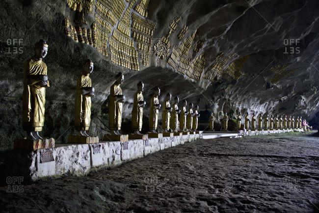 Rows of Buddha statues in Saddar Cave, Hpa-An, Burma