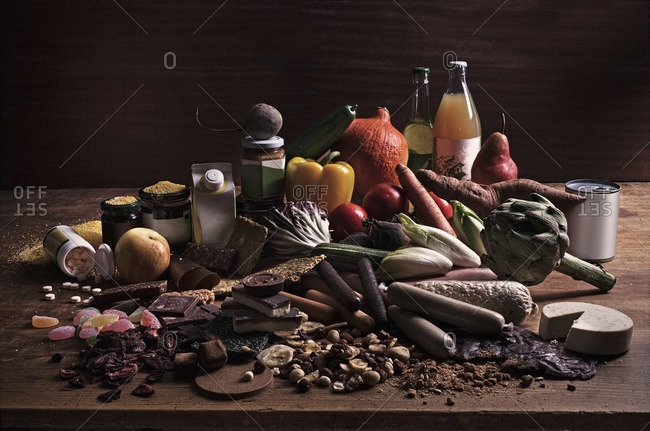 A variety of fresh and processed foods in a heap on a table