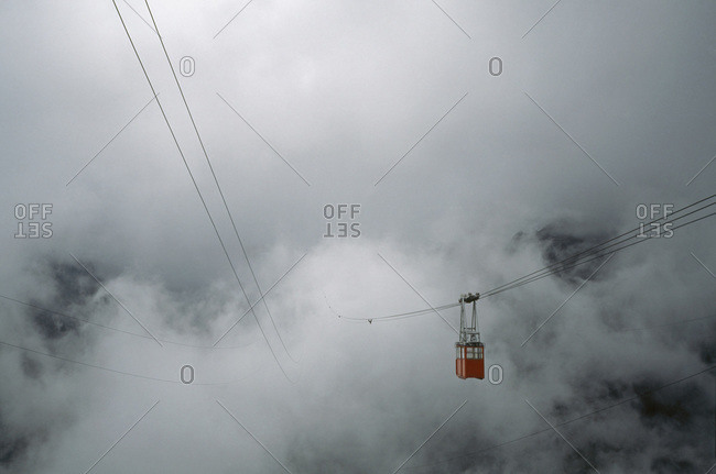 Overhead cable car traveling into mist, M��rida, Venezuela