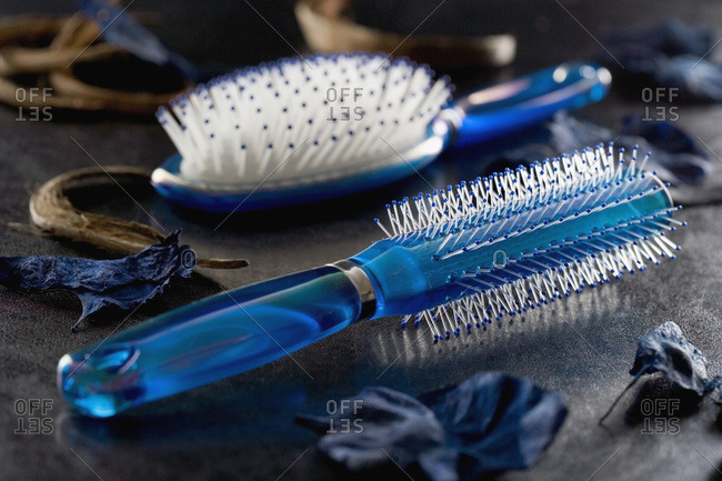 Close-up of two hairbrushes - Offset