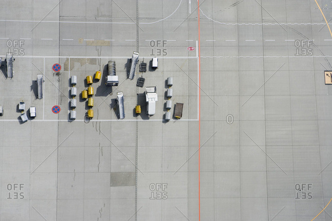 Aerial view of tarmac markings and equipment at airport