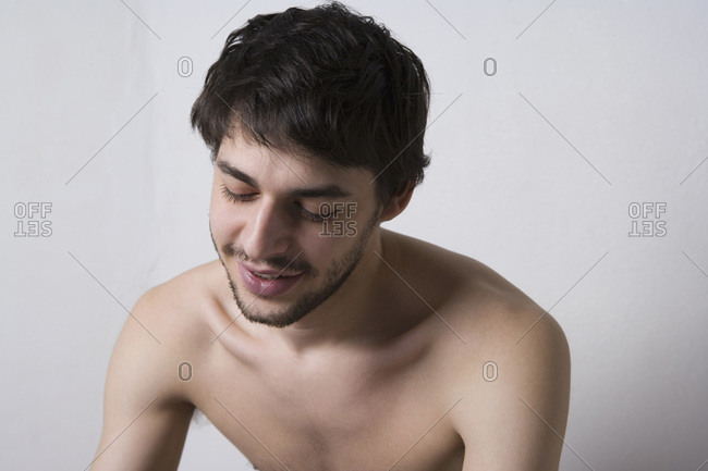 Young man sitting shirtless
