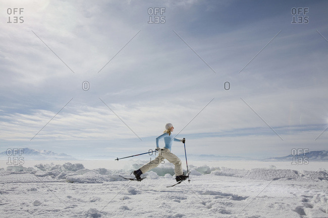 A woman snowshoeing - Offset Collection