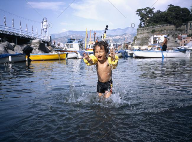 A boy splashing in the sea