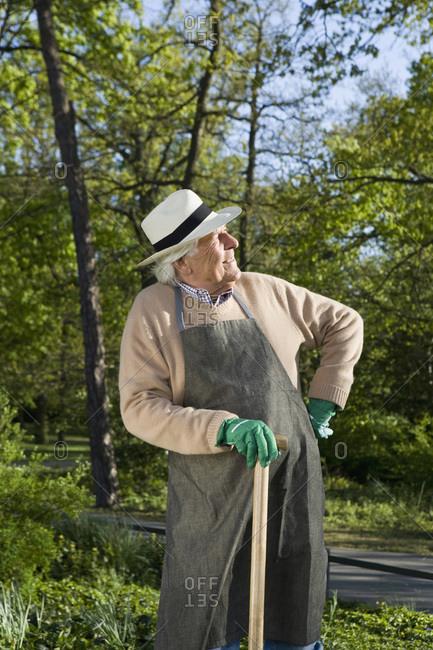 A senior man resting while doing gardening
