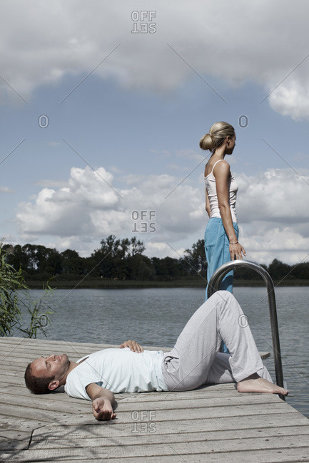 A couple relaxing on a health spa jetty
