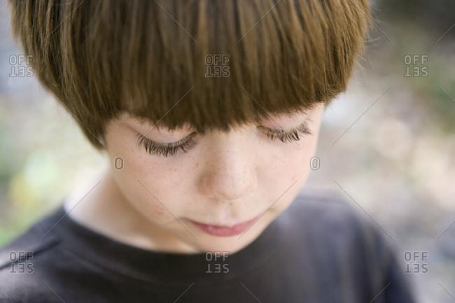 Portrait of a boy looking down