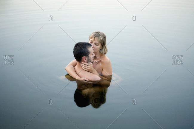 Couple embracing in water - Offset
