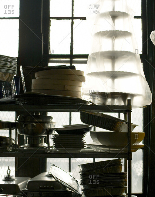 A store room with plenty of kitchen accessories.