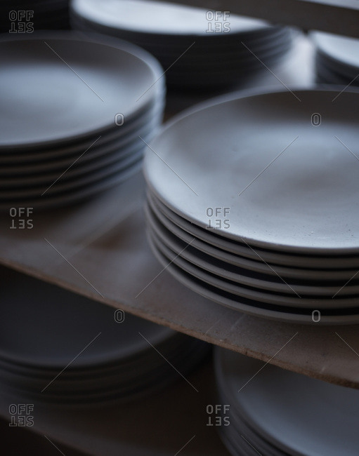 White plates in a storage of a restaurant