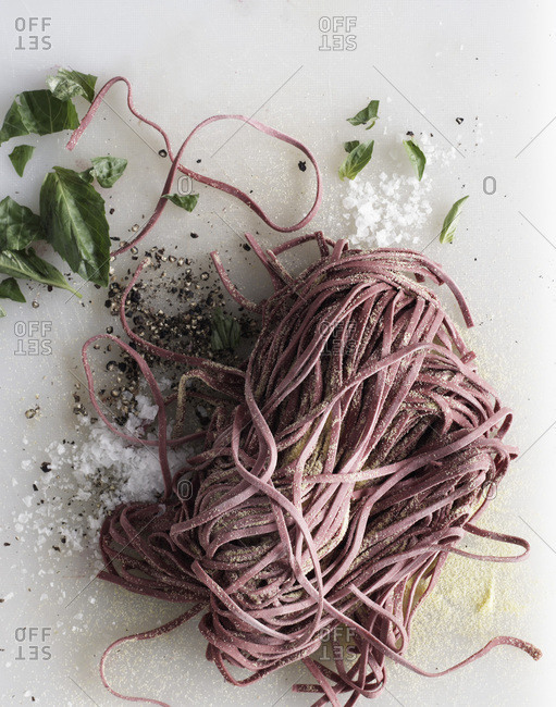 Raw red pasta with ingredients from above.