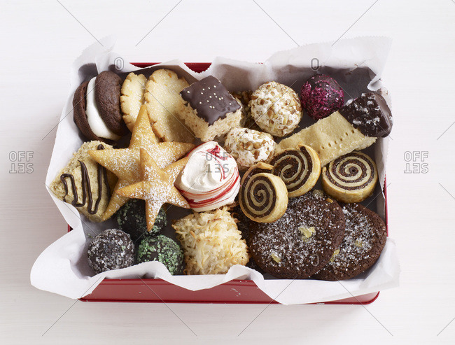 Different christmas cookies in a cookie box from above.