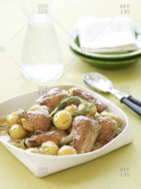 Roasted meat garnished by boiled potatoes.