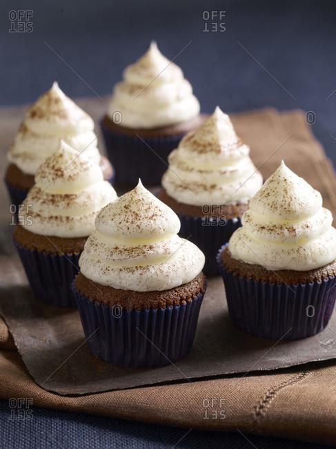 Close up of tempting meringue cupcakes.