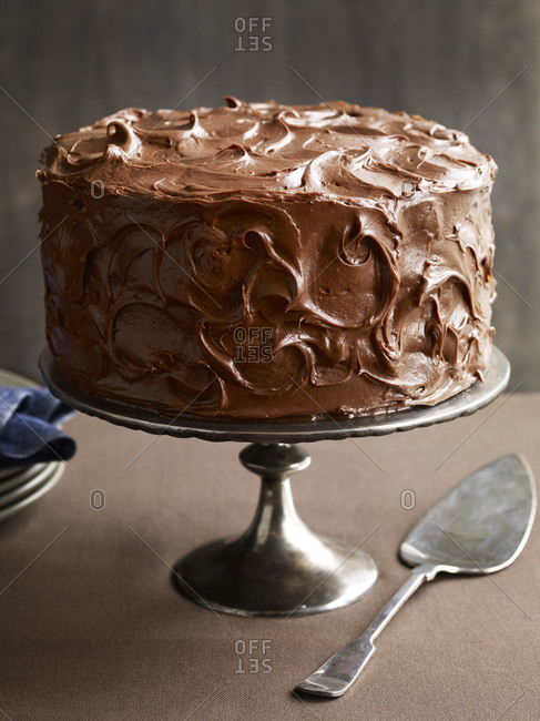 Tempting whole chocolate cake with chocolate icing.