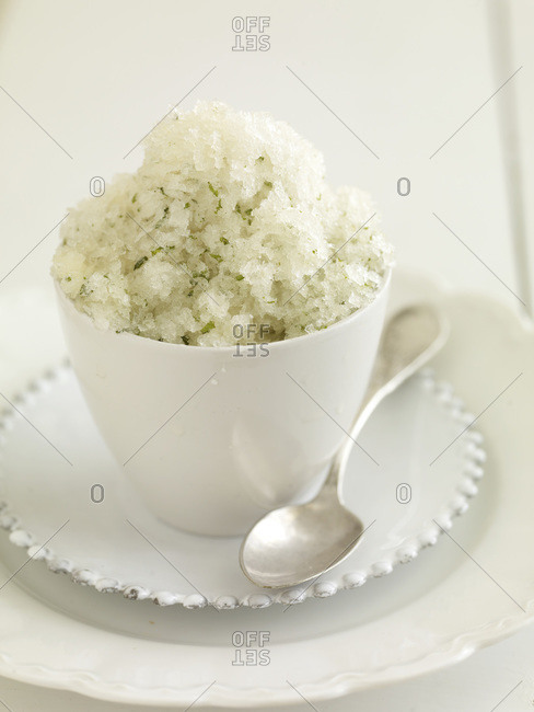 Close up of a cup of fresh lime granita.