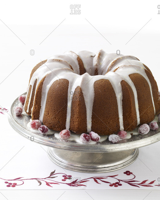 Glazed bundt cake on a cake stand.