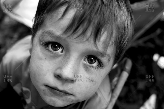 Young boy with filthy face staring into the camera