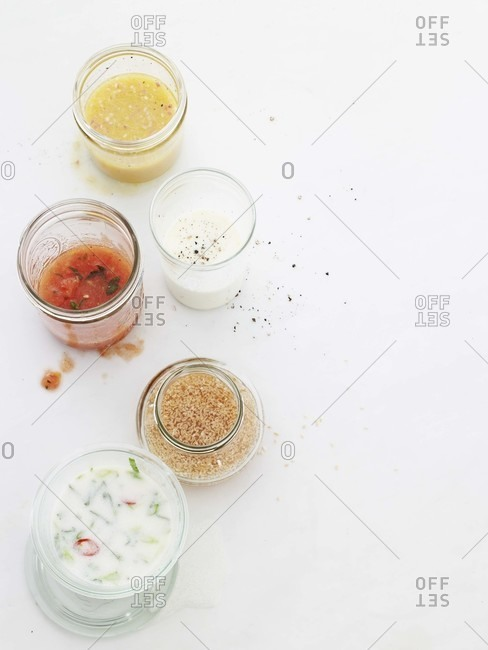 Five different salad dressing from above.