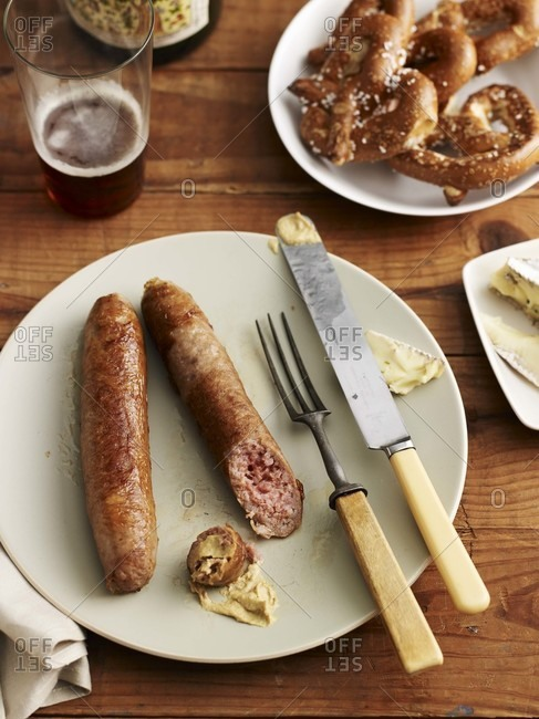 Sausages, pretzels and beer on a wooden table