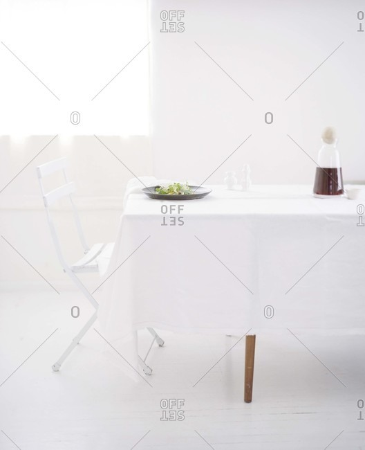 White interior with a chair and table