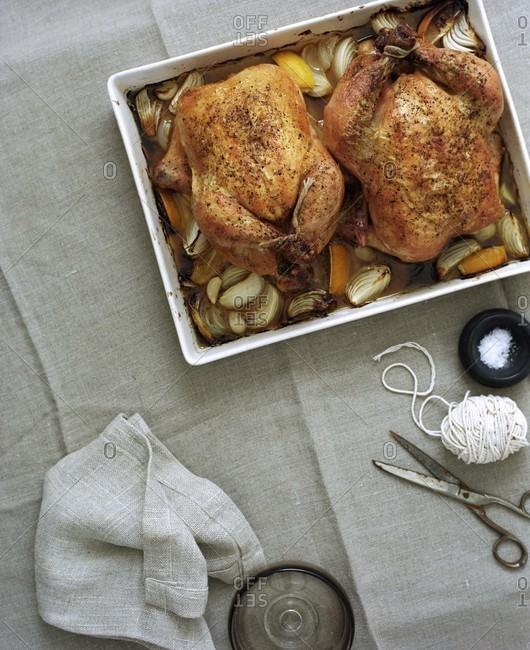 Two roasted chickens with onion and carrot