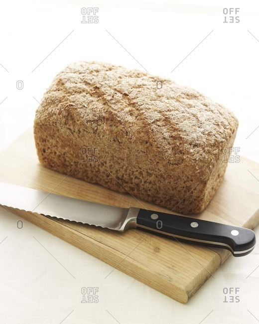 Whole wheat loaf with knife