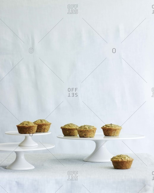 Zucchini muffins on cake stands.