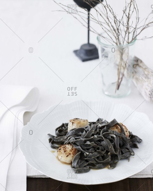 Squid ink pasta and scallops