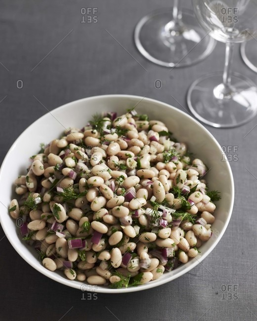 White bean salad with chopped onion and dill