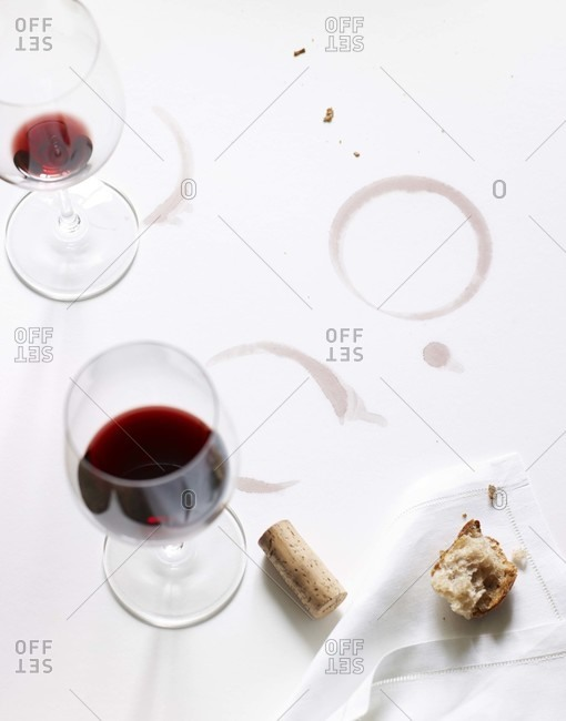Glass of red wine and strains on a white tablecloth